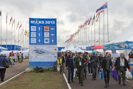 crowded space: ZHUKOVSKY, RUSSIA - SEP 01, 2013: The visitors come from the exhibition International Aviation and Space salon MAKS-2013