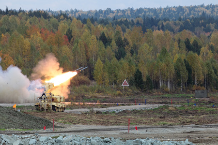 NIZHNY TAGIL, RUSSIA - SEP 25, 2013: The international exhibition of armament, military equipment and ammunition RUSSIA ARMS EXPO (RAE-2013). Volley russian Heavy Flame Thrower System, multiple rocket launcher TOS-1 Editorial