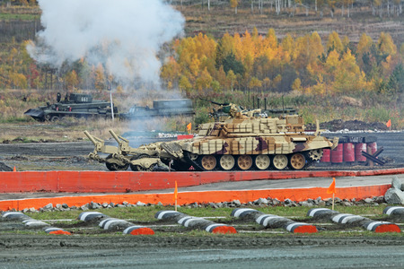 industrially: NIZHNY TAGIL, RUSSIA - SEP 26, 2013: The international exhibition of armament, military equipment and ammunition RUSSIA ARMS EXPO (RAE-2013). Armored vehicle for demining BMR3M