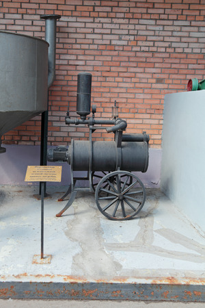 cooling system: MOSCOW, RUSSIA, OCHAKOVO BREWERY - JUN 13: The exposition of retro-equipment for brewing. Old mobile cooling system beer cellar Editorial