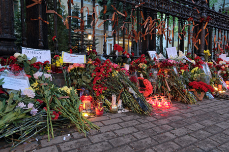 massacre: MOSCOW, RUSSIA - MAY 05, 2014: Flowers and candles near the Embassy of Ukraine, which laid the grieving Russians due to with the tragic events in city Odessa