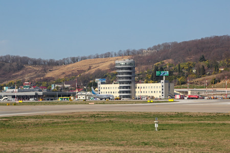 krasnodar region: SOCHI, ADLER, RUSSIA - FEB 24, 2014: The building of the Adler airport and tower control office Editorial