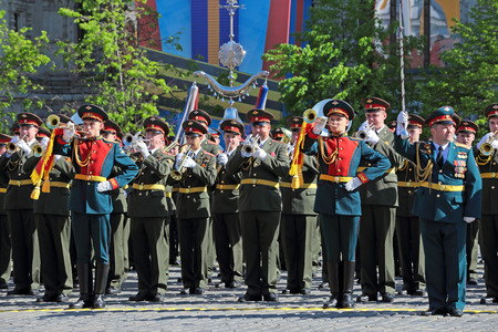 MOSCOW, RUSSIA - MAY 09, 2014: Celebration of the 69th anniversary of the Victory Day (WWII). Solemn passage of military hardware on Red Square. A military band plays the national anthem