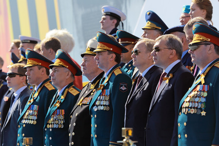 MOSCOW, RUSSIA - MAY 09, 2014: Celebration of the 69th anniversary of the Victory Day (WWII) on Red Square. The leadership of the Ministry of defense of Russia on the VIP tribune
