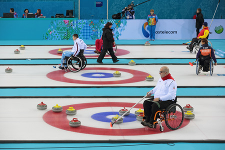 olympiad: SOCHI, RUSSIA - MAR 8, 2014: Paralympic winter games in curling center Ice cube, wheelchair curling, the round Robin, session 1