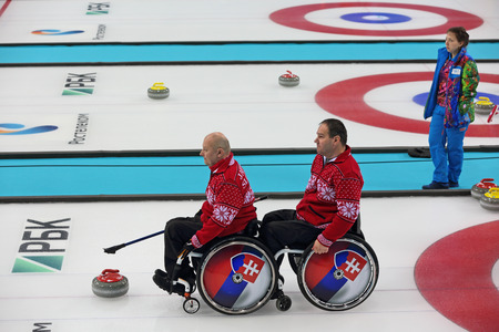 SOCHI, RUSSIA - MAR 8, 2014: Paralympic winter games in curling center Ice cube, wheelchair curling, the round Robin, session 1. Team Slovakia on the playing field
