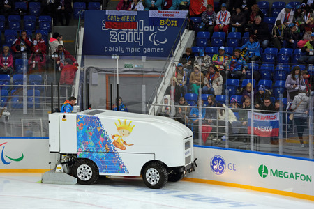 olympiad: SOCHI, RUSSIA - MAR 12, 2014: Paralympic winter games. Shayba Arena, ice sledge hockey Italy-Sweden. Resurfacer prepares the ice Editorial