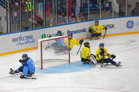 SOCHI, RUSSIA - MAR 12, 2014: Paralympic winter games in ice Arena Shayba. The sledge hockey, match Italy-Sweden. The teams in hockey gate