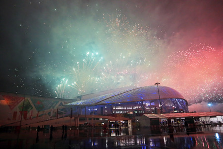 stadia: SOCHI, ADLER, RUSSIA - MAR 16, 2014: Olympic Park in Adlersky District, Krasnodar Krai. Fireworks over the Fisht Olimpic Stadium during the closing ceremony of the Paralympic winter games 2014