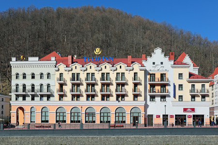 krasnodar region: SOCHI, RUSSIA - MAR 25, 2014: Alpine ski Resort Rosa Khutor in Krasnaya Polyana - popular center of skiing and snowboard, venue for the 2014 winter sports competitions. Hotel Tulip Inn on the banks of the river Mzymta