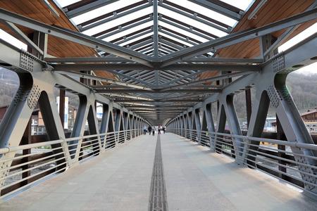 bridged: SOCHI, RUSSIA - MAR 25, 2014: Pedestrian bridge over the river Mzymta at Rosa Khutor Alpine ski Resort in Krasnaya Polyana - popular center of skiing and snowboard Editorial