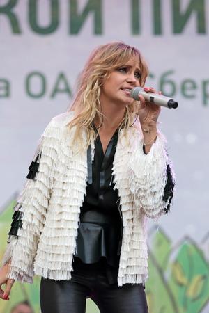 gig: MOSCOW, RUSSIA - AUG 30, 2014: Russian pop singer Glukoza (Natalia Ilinichna Ionova) at a corporate gig of Sberbank of Russia Editorial