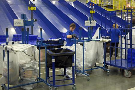 unitary: VNUKOVO, MOSCOW REGION, RUSSIA - APR 7, 2015: Russian Post. Logistics center in Vnukovo, working around conveyor