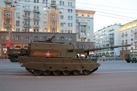 propelled: MOSCOW, RUSSIA - MAY 04, 2015: Rehearsal celebration of the 70th anniversary of the Victory Day (WWII). Military equipment on Tverskaya street prepares to travel to the Red Square. The Coalition-SV - Russian project self-propelled artillery class self-pro Editorial