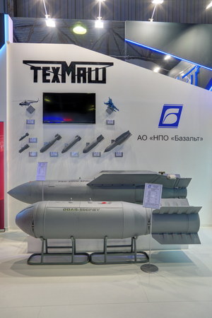 unified: ZHUKOVSKY, MOSCOW REGION, RUSSIA - AUG 28, 2015: Stand Join Stock Company Bazalt at the International Aviation and Space salon MAKS-2015. Fuel-air explosive aircraft bomb ODAB-500PMV and unified glide cluster bomb unit PBK-500U Editorial