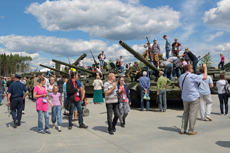 industrially: KUBINKA, MOSCOW OBLAST, RUSSIA - JUN 17, 2015: International military-technical forum ARMY-2015 in military-Patriotic park. Visitors view the exhibited military vehicles