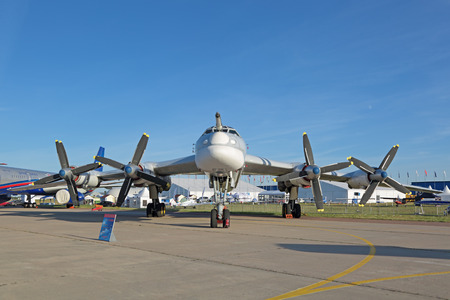 engine powered: ZHUKOVSKY, MOSCOW REGION, RUSSIA - AUG 24, 2015: The Tupolev Tu-95 (Bear) is a large, four-engine turboprop-powered strategic bomber and missile platform at the International Aviation and Space salon MAKS-2015