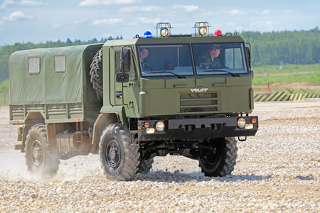wheel tractor: MILITARY GROUND ALABINO, MOSCOW OBLAST, RUSSIA - JUN 18, 2015: The demonstration of the capabilities of a military truck VOLAT production MZKT - Minsk Wheel Tractor Plant at the International military-technical forum ARMY-2015 Editorial