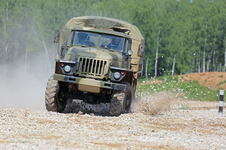 capabilities: MILITARY GROUND ALABINO, MOSCOW OBLAST, RUSSIA - JUN 18, 2015: The demonstration of the capabilities of a military truck Ural-43206 at the International military-technical forum ARMY-2015