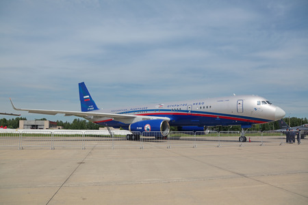 cielos abiertos: KUBINKA, MOSCOW OBLAST, RUSSIA - JUN 19, 2015: The Tupolev Tu-214  is a Russian twin-engined medium-range jet airliner flying on Treaty on Open Skies at the International military-technical forum ARMY-2015 at the Kubinka air base
