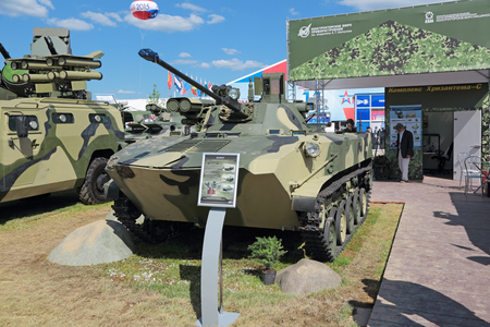unified: KUBINKA, MOSCOW OBLAST, RUSSIA - JUN 18, 2015: International military-technical forum ARMY-2015 in military-Patriotic park. The Combat Vehicle of the Airborne BMD-2 (amphibious infantry fighting vehicle) with the new unified tower Bereg Editorial