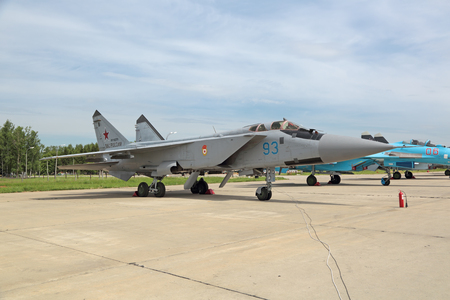 mig: KUBINKA, MOSCOW OBLAST, RUSSIA - JUN 19, 2015: The Mikoyan MiG-31 BM (NATO reporting name: Foxhound) is a supersonic interceptor aircraft developed for use by the Soviet Air Forces at the International military-technical forum ARMY-2015 at the Kubinka air