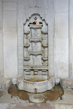 poisoned: BAKHCHISARAY, REPUBLIC CRIMEA, RUSSIA - AUG 12, 2014: The fountain of tears in Bakhchisaray Palace (Hansaray) the residence of the Crimean khans XVI century. Built according to legend, in honor of poisoned beloved wife of the Khan. Became known for the po Editorial
