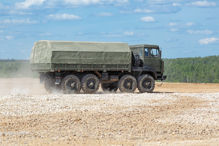 capabilities: MILITARY GROUND ALABINO, MOSCOW OBLAST, RUSSIA - JUN 18, 2015: The demonstration of the capabilities of a military truck KamAZ-6560 at the International military-technical forum ARMY-2015