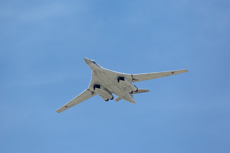 supersonic: MOSCOW, RUSSIA - MAY 9, 2015: Military parade of 70th anniversaries of a victory devoted to celebrating in WWII. The supersonic strategic bomber and missile platform with changing a wing TU-160 White swan (Blackjack) in the sky over Moscow flies up to R