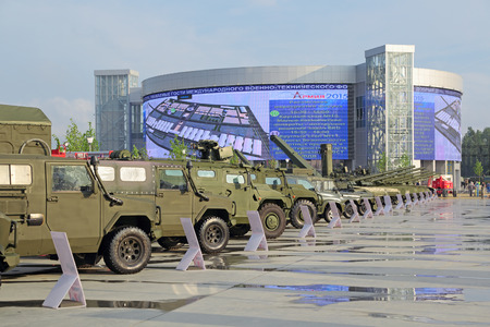 industrially: KUBINKA, MOSCOW OBLAST, RUSSIA - JUN 15, 2015: International military-technical forum ARMY-2015 in military-Patriotic park. Visitors view the exhibited military vehicles Editorial