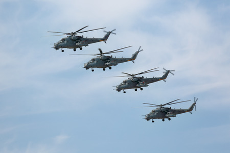 MOSCOW, RUSSIA - MAY 09, 2015: Celebration of the 70th anniversary of the Victory Day (WWII). Flight of aircraft over the city, a group of military helicopters Mil Mi-24 (Hind) in the sky Editorial