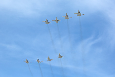 supersonic: MOSCOW, RUSSIA — MAY 9, 2015: Military parade of 70th anniversaries of a victory devoted to celebrating in WWII. Group of planes Sukhoi Su-24 (Fencer) is a supersonic, all-weather attack aircraftinterdictor developed in the Soviet Union in the sky over Editorial