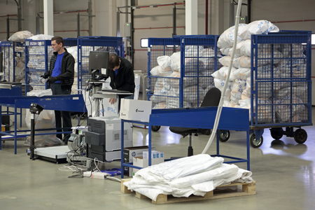 unitary: VNUKOVO, MOSCOW REGION, RUSSIA - APR 7, 2015: Russian Post. Logistics center in Vnukovo, employees in the workplace