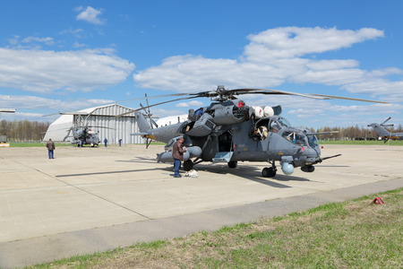 may fly: KUBINKA, MOSCOW REGION, RUSSIA - MAY 05, 2015: The Mi-35 a large helicopter gunship and attack helicopter preparing to fly over Moscow in rehearsal 70 anniversary of the Victory Parade in WWII Editorial