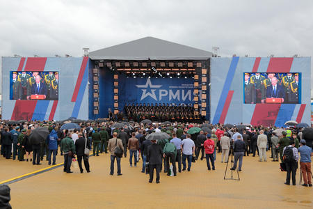 congratulatory: KUBINKA, MOSCOW OBLAST, RUSSIA - JUN 16, 2015: The opening ceremony of the International military-technical forum ARMY-2015 in military-Patriotic park. The President of the Russian Federation Vladimir Vladimirovich Putin says congratulatory speech