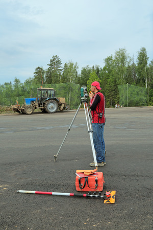 surveying: KUBINKA, MOSCOW OBLAST, RUSSIA - JUN 15, 2015: The construction of military-Patriotic Park Patriot for the International military-technical forum ARMY-2015.  The surveyor makes topographic surveying