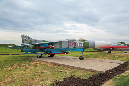 supersonic: KUBINKA, MOSCOW OBLAST, RUSSIA - JUN 19, 2015: The Mikoyan-Gurevich MiG-23 (NATO reporting name: Flogger) is a variable-geometry retro supersonic fighter aircraft at the International military-technical forum ARMY-2015 at the Kubinka air base Editorial