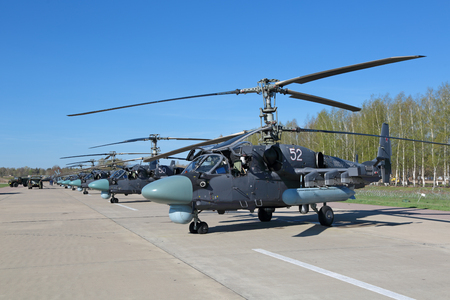 may fly: KUBINKA, MOSCOW REGION, RUSSIA - MAY 05, 2015: The Ka-52 Alligator - Russian combat helicopters - commanders car army aviation and marine corps preparing to fly over Moscow in rehearsal 70 anniversary of the Victory Parade in WWII