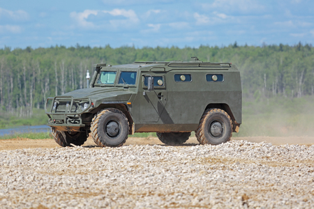 capabilities: MILITARY GROUND ALABINO, MOSCOW REGION, RUSSIA - JUN 18, 2015: The demonstration of the capabilities of a Russian 4x4, multipurpose, all-terrain infantry mobility vehicle GAZ Tigr at the International military-technical forum ARMY-2015