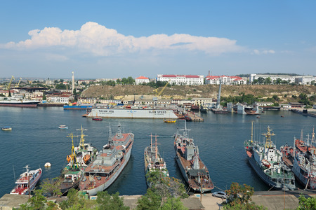 drydock: SEVASTOPOL, REPUBLIC OF CRIMEA, RUSSIA - AUG 10, 2014: View of the South Bay town and moored it ships Editorial
