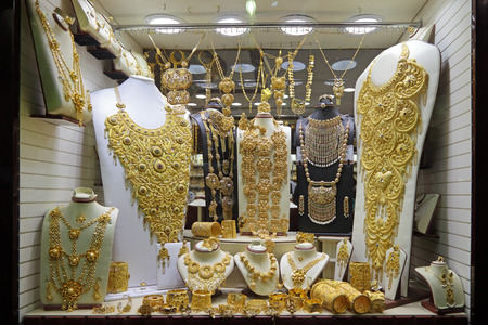 lavish: DUBAI, UNITED ARAB EMIRATES (UAE) - FEB 04, 2014: Luxury gold jewelry in vitrine jewelry store