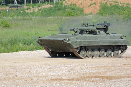 self testing: MILITARY GROUND ALABINO, MOSCOW OBLAST, RUSSIA - JUN 18, 2015: The BMP-2M (infantry combat vehicle) is a modernized second-generation, amphibious infantry fighting vehicle at the International military-technical forum ARMY-2015
