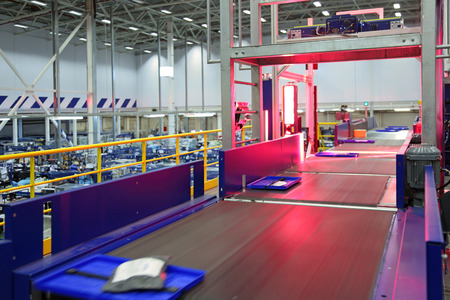 VNUKOVO, MOSCOW REGION, RUSSIA - APR 7, 2015: Russian Post. Logistics center in Vnukovo, automatic machine for bar code scanning correspondence with a moving conveyor belt