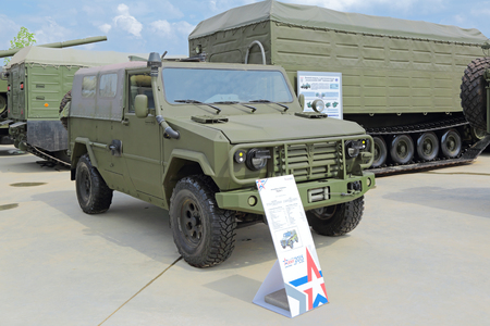 armored car: KUBINKA, MOSCOW OBLAST, RUSSIA - JUN 15, 2015: International military-technical forum ARMY-2015 in military-Patriotic park. The armored car Scorpion LSHA-1
