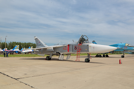 frontline: KUBINKA, MOSCOW OBLAST, RUSSIA - JUN 19, 2015: The Sukhoi Su-24 (NATO reporting name: Fencer) is a Russian supersonic, all-weather, variable-sweep wing tactical (frontline) bomber at the International military-technical forum ARMY-2015 at the Kubinka air