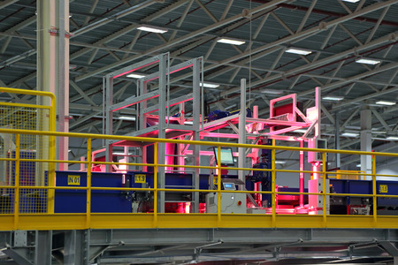 automatic machine: VNUKOVO, MOSCOW REGION, RUSSIA - APR 7, 2015: Russian Post. Logistics center in Vnukovo, automatic machine for bar code scanning correspondence with a moving conveyor belt Editorial