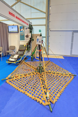outboard: KUBINKA, MOSCOW OBLAST, RUSSIA - JUN 16, 2015: Outboard rescue platform SRP-MM for helicopters produced by Mikromontazh at the International military-technical forum ARMY-2015 in military-Patriotic park Editorial