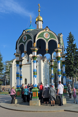 sacred trinity: MOSCOW REGION, SERGIYEV POSAD, RUSSIA - MAY 1, 2014: Trinity Lavra of St. Sergius - the largest Orthodox male monastery in Russia. Water chapel-canopy, parishioners are gaining Holy water