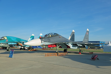 sm: ZHUKOVSKY, RUSSIA - AUG 24, 2015: Demonstration jet plane Sukhoi Su-30 SM (Flanker-C) is two-seat, twin-engine supermaneuverable multirole fighter at the International Aviation and Space salon MAKS-2015