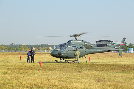 warms: ZHUKOVSKY, MOSCOW REGION, RUSSIA - AUG 27, 2015: Eurocopter AS 355N Ecureuil - single-engine light France helicopter belonging to the Ministry of internal Affairs of Russia the engine warms up at the International Aviation and Space salon MAKS-2015